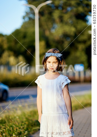 cute girl pose on the city street at sunset  68359730