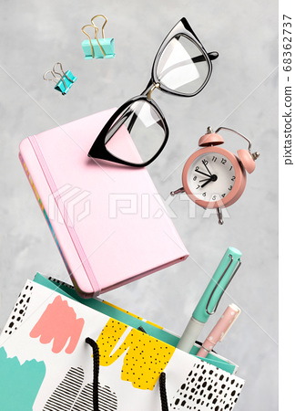 Office supplies stationery levitate over concrete 68362737