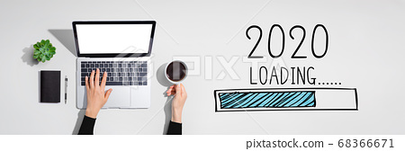 Loading new year 2020 with person using laptop computer 68366671