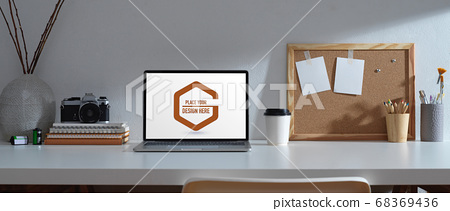 Worktable with mock up laptop, stationery, camera, 68369436