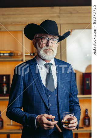 Concept of old age wisdom and experience. Old man with cigar and 68373725