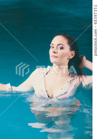 Portrait of mysterious seductive woman in water. 68397351