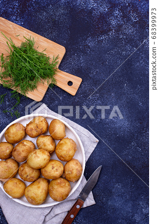 Young uncooked fresh potato and dill 68399973