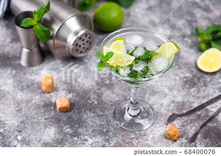 Martini cocktail with lime and mint. 68400076