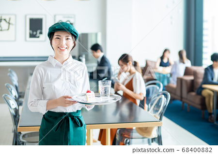 Young clerk in cafe 68400882