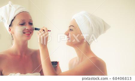 Beautiful woman having a facial treatment at spa. 68406813