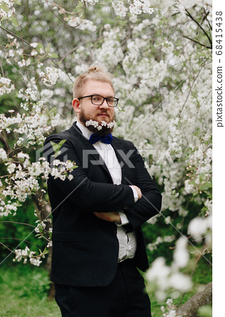 a grown man with white flowers in his beard 68415438