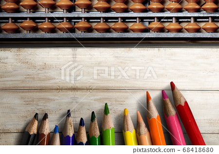 Abacus and colored pencils on wooden table 68418680