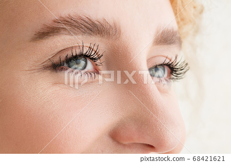 Close up of face of beautiful caucasian young woman, focus on eyes 68421621