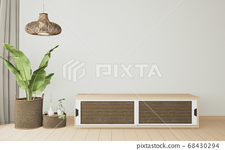 tropical room interior with cabinet and plants 68430294