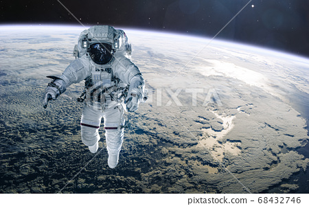 Astronaut on background of the Earth. Solar system. Science fiction 68432746