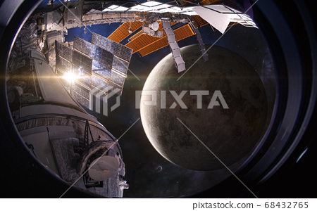 The orbit of the moon. View from the porthole of a space station. Science fiction 68432765