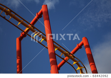Roller Coaster Ride in Amusement Park. Entertainment and Adventure 68442092