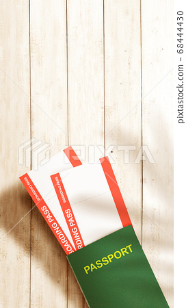 Ticket and passport on wooden table background 68444430