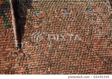 Details of red tiled roofs of medieval Brasov town in Transylvania, Romania. Europe 68446399