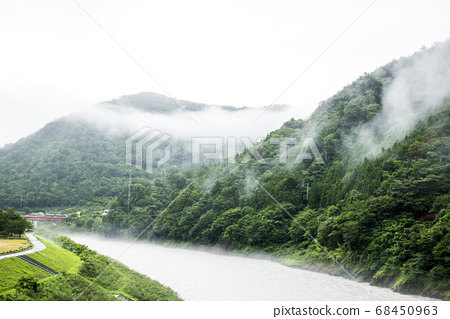 Mountain and river landscape cloudy in bad weather 68450963