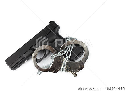 gun and metal handcuff with chain isolated on white background. crime concept 68464456