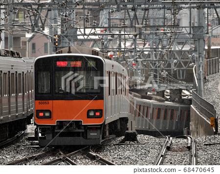 Railroad running in the rain 68470645