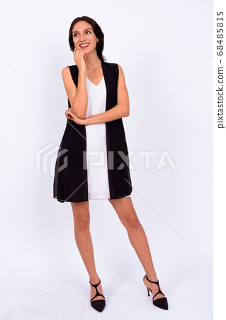 Portrait of happy young beautiful businesswoman against white background 68485815