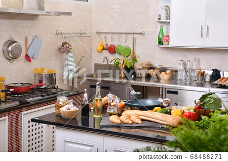 Kitchen full of ingredients and utensils ready to be used 68488271