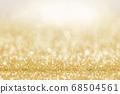Shiny golden lights background 68504561