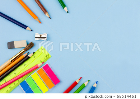School supplies scattered on a blue background. 68514461