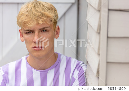 Boy teenager teen blonde male young man wearing striped t-shirt 68514899