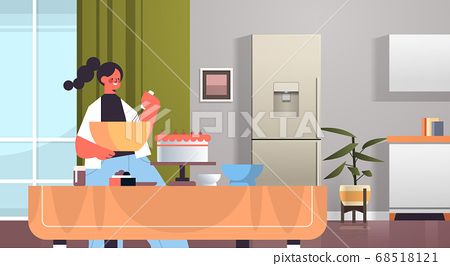 happy woman preparing sweet cake at home cooking concept modern kitchen interior 68518121