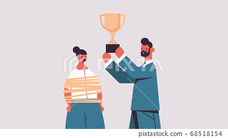 businessman holding trophy cup near tied businesswoman with duct tape on mouth gender inequality discrimination 68518154