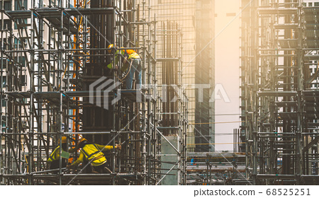 Asian construction workers installing concrete 68525251