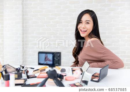 Young beautiful Asian woman beauty influencer recording cosmetic makeup video 68537085