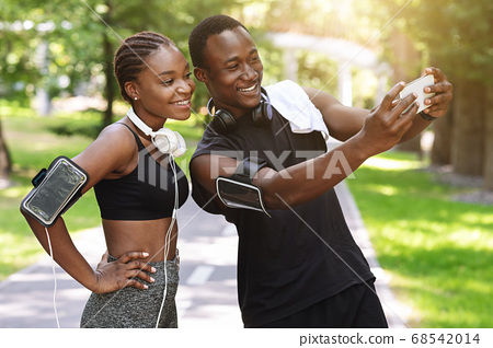 Black Millennial Couple Taking Selfie On Smartphone While Doing Sport Together Outdoors 68542014