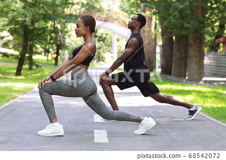Sporty Lifestyle. Black Fitness Couple Working Out Together In Park, Stretching Muscles 68542072