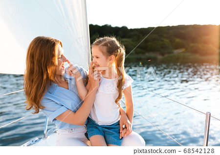 Mother And Daughter Having Fun During Sailboat Tour Outdoors 68542128