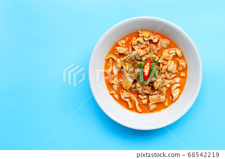 Panaeng Curry with pork  in white bowl on blue 68542219