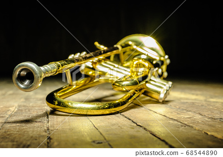 Brass instrument - trumpet on stage with backlight 68544890