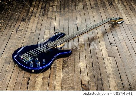 beautiful blue bass guitar on a wooden surface 68544941