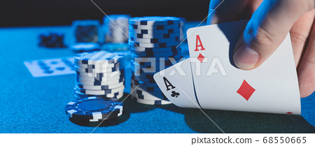 Man plays poker in the casino 68550665