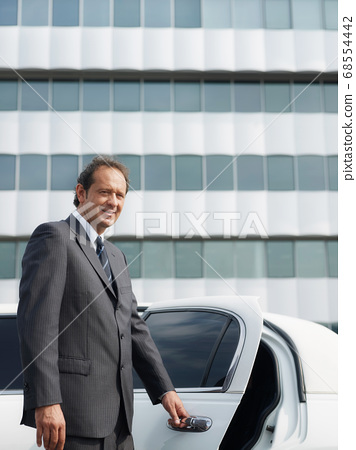 Portrait Of Man Working As Driver In White Limousine 68554442