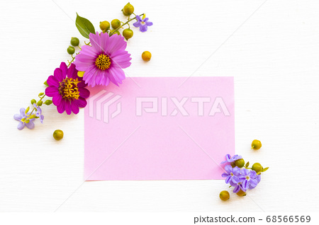 notepaper with pink flowers cosmos, zinnia ,purple flowers arrnagement flat lay postcard style 68566569