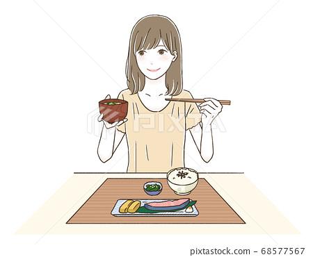 일본의 아침을 먹는 여자 68577567