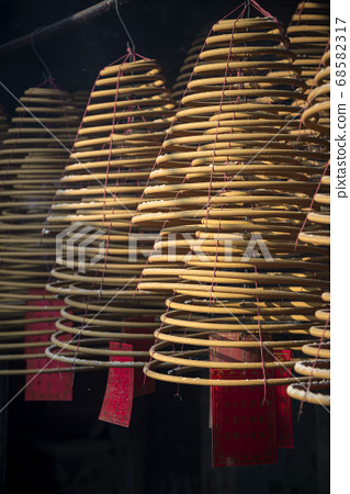 traditional  burning incense coils inside chinese 68582317