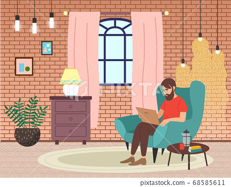 Bearded man sitting on the armchair in living room interior and correspondence surfing the Internet 68585611