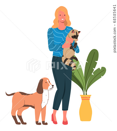 Young smiling woman with cute raccoon in hands and a dog. Happy mistress with domestic animals 68585641