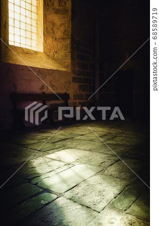 Light from an ancient medieval window illuminates the floor 68589719