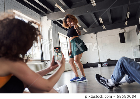 Happy Afro American woman is showing new dance 68590684