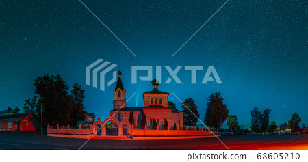 Korma Village, Dobrush District, Belarus. Comet Neowise C2020f3 In Night Starry Sky Above St. John The Korma Convent Church In Korma Village. Famous Orthodox Church And Historic Heritage 68605210