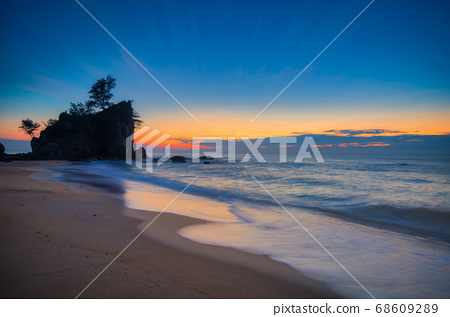 sunrise at tropical beach against golden sky and cloud balckground 68609289