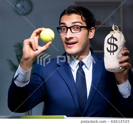Young employee with tennis ball 68618585