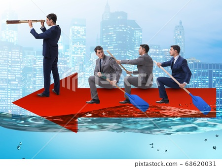Teamwork concept with businessmen on boat 68620031